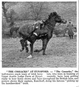 """The Cossacks"" the well-known crack team of trick horse riders who were in training at Upper Austin Lodge at Eynsford recently, have been getting ready to tour horse shows and fairs throughout the British Isles, and picture shows their captain, Korolkoff, doing his famous ""picking up the handkerchief"" trick. Cutting from Julia Da Costa. Copyright of this image remains with her."